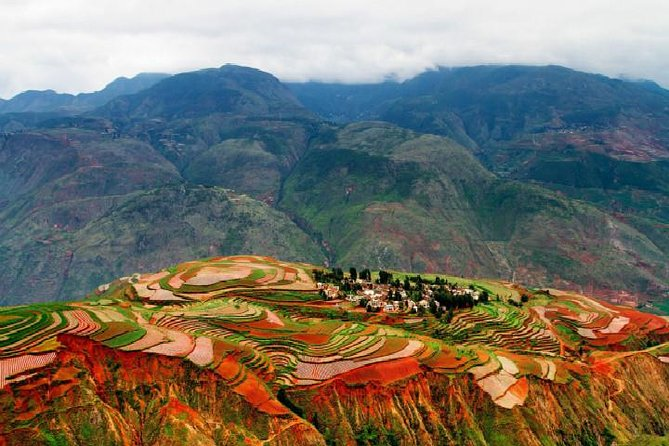 """Yunnan Dongchuan is like a colorful rainbow, under the sunlight, it offers various color. Yunnn is a place very worth traveling, the beauty of Yunnan is very memorable and rewarding. This line will give you a colorful tour including photographs in front of the third largest bridge in Asia, Colorful dam Tangdian, ideal sunset spot Luoxiagou and sunrise spot Damakan, High terrain Qicaipo, grand-view path at Jinxiuyuan, lepuao with most magnificent red earth, """"Kunming's Jade"""" - Green Lake Park. You will find there is a place in the world which provides almost all colors in the world, so much fascinating and adventurous. Your tour includes one night accommodations in Dongchuan, , transportation and lunch."""