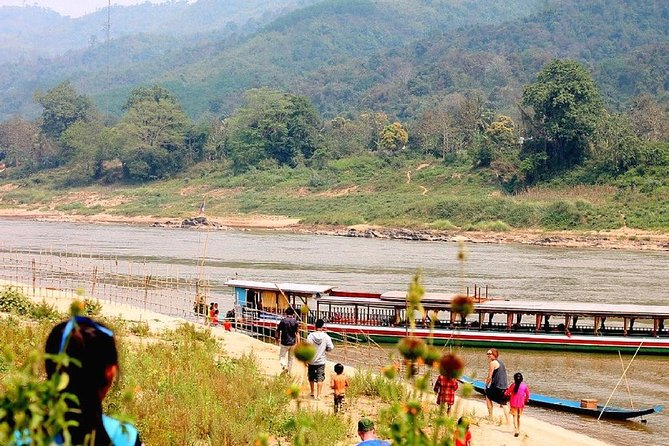 "2 Days Mekong River Cruise from Thailand - Laos border ""Huay Xai"" to Luang Prabang, overnight in Bakbeng. We will stop and visit the tribe villages and Pak ou cave on a traditional Laos Style boat, with top cover and comfortable seating area. package including two lunches, tea, Lao tea, and coffee all the time. The boat is large enough to bring you the comfortable and walk around for the fresh air and stress-fullness. operated by Mekong Smile or Shompoo Cruises"
