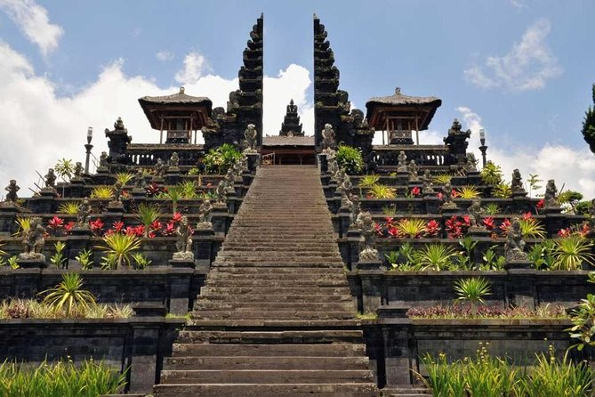 """This tour takes you to Besakih Temple at the foot of Mouth Agung, through rice field terrace and on to Bali's scenic East Coast. First stop is Kerta Gosa, the hall of justice, in Klungkung, which dates from the 18th century.<br><br>You trip continues up into the mountains, stopping to admire the view from Bukit Jambul over rice terraces with the sea glistening in the distance. Then its into Besakih Temple, almost 1.000 m above sea level. Besakih is the """"Mother Temple"""" of Bali and probably originated as a prehistoric sanctuary where offerings were made to the God of Mount Agung.<br><br>Back at sea level, we visit Tenganan - one of the original Bali """"Aga"""" villages where traditions have changes little over the centuries. Our driver continues through the beach resort of Candi Dasa to Kusamba, a small fishing village, followed by Goa Lawah (Bat Cave) where the walls of the cave literally vibrate with thousand of Bats. The cave is considered to be holy, with shrines and a temple protecting to entrance."""
