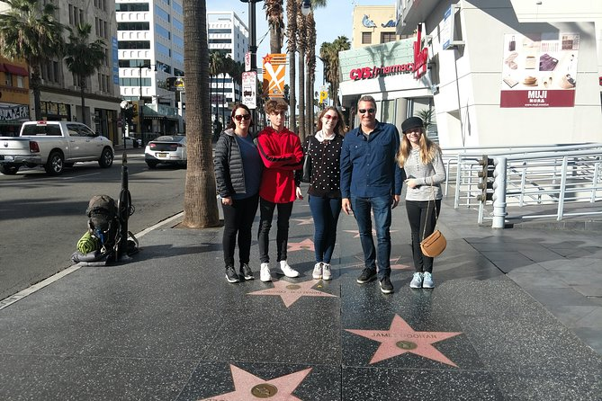 Enjoy an 8-9 hour group tour of the highlights of Hollywood to Beverly Hills from Orange County. See sights including the famous Hollywood sign, Grauman's Chinese Theatre, and the homes of some of the many celebrities who live in the area. Enjoy some free time on Hollywood Boulevard and the Farmers Market and the Grove to shop La Brea Tar Pits and Urban Street Lights, 10 segments of the Berlin Wall and have some lunch . We also offer free WIFI on this .8-9 hour tour has more then 6 stops for photos.