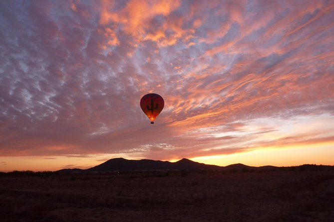 Take in the beautiful Arizona Sonoran Desert at sunset like never before! Floating 2,000-5,000 feet over the desert in a hot air balloon, the 360 degree unobstructed views and peacefulness of flight is breathtaking. Following your 45-60 minute hot air balloon flight, guests are treated to chilled champagne and gourmet evening hors d'oeuvres in the desert, the perfect end to the day.