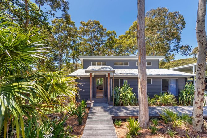 We are offering our guests a luxury coastal weekend away, 3 hours north of Sydney.<br><br>Experience the beautiful beaches and national parks. Cook lazy dinners in the gourmet kitchen while watching the birds on the deck.<br><br>Bathe in the outdoor stone bath or stay toasty and warm in front of the gas fire place.<br><br>Free wifi, Apple TV, ice maker fridge<br><br>Included in the experience is the hire of a Tesla Model S 75 2017. Car is capable of travelling 400km on one charge.<br><br>There is a supercharger located exactly half way from Sydney and the house. Depending on driver and driving conditions you may need stop and charge for 15mins. All charging is free.<br><br>Experience the safest car in the world with auto pilot.