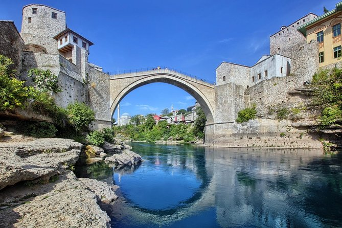 Enjoy a full-day guided group tour to Mostar and the Kravice waterfalls. Mostar is situated on the Neretva River and is the fifth-largest city in the country. Named after the bridge keepers (mostari) who in the medieval times guarded the Stari Most (Old Bridge) over the Neretva. The Old Bridge, built by the Ottomans in the 16th century, is one of Bosnia and Herzegovina's most recognizable landmarks, and is considered one of the most exemplary pieces of Islamic architecture in the Balkans. The natural splendor of Kravice must be seen to be believed; a cool refreshing mist belies the beauty of a crystal clear aquatic marvel that is well worth seeing. In the late afternoon, you will return back to your hotel.<br>