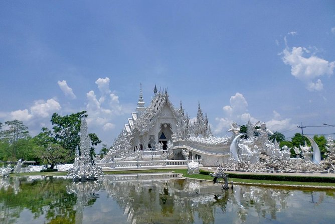 We depart from your hotel at 07:30 a.m. to Chiang Rai Province which takes about a 3-hour drive. Firstly, we have a short break at Mae Khachan Hot Spring, surrounded by spectacular hills and, it is the shelter of the large and shady tree. Then, we continue to visit Rong Khun Temple, more well-known among foreigners as the White Temple, is a contemporary unconventional Buddhist temple in Chiang Rai Province, Thailand. It was designed by Chalermchai Kositpipat in 1997. Lunch will be provided at a local restaurant. After that, continue to Blue Temple and Black House where is the proud work of Thawan Duchanee, a Chiang Rai born Thai artist who has developed a style of work representing the darkness in humanity. With lots of red and black hues, skins, skulls and various other animal parts made into eerie artwork.