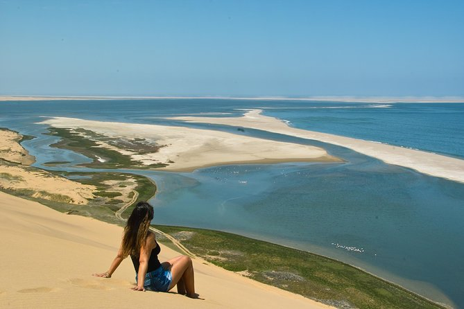 Experience the adventure and beauty of exploring the Namib desert with your driver/guide. There are many interesting sights to see including desert fauna and flora, and giant sand dunes. Navigate the thin stretch of coast where giant dunes meet the Atlantic ocean on your way to Sandwich Lagoon. <br><br>Hotel pickups in Walvis Bay ( Swakopmund pickups at N$100.00 per person) and lunch that includes finger snacks, sparkling wine and something sweet is included.
