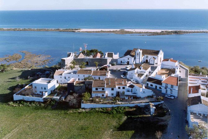 """Explore the peaceful East Algarve with its charming towns, elegant architecture and sights steeped in history. <br><br>This must-do day trip includes guided tours to the old town of Algarve capital - Faro, Olhão and the charming Tavira city - """"Venice of Algarve"""" with 37 churches and houses with peculiar roofs named """"4 águas"""", you will also have time to shop or visit on your own the Castle of Tavira: a ruined monument believed to date to Neolithic times. Enjoy free time to soak up the laid-back pace of the region in the fishing town of Olhão, pass by Gilão River and take your breath away with a stunning view in Cacela Velha. <br><br>Make use of a hotel pickup and drop-off service that covers hotels all over Algarve West region, from Quarteira to Alvor."""