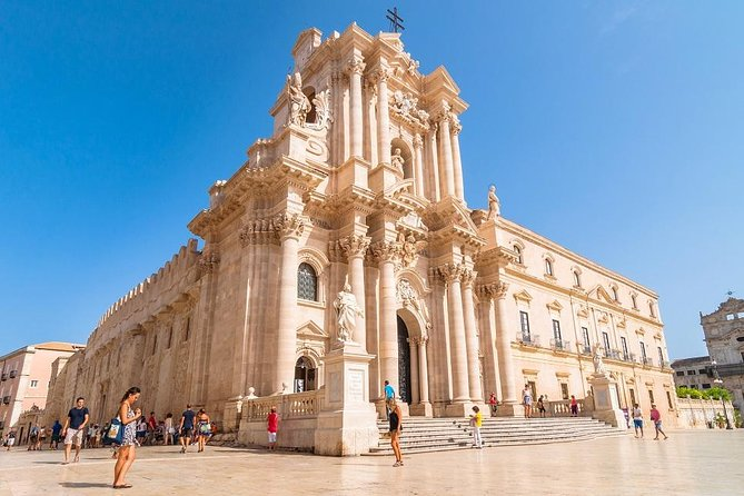 Pick-up from accomodation and transfer to Syracuse where you will visit the wonderful Neapolis Archaeological Park for a walk immersed in the history of the great Greek civilization. Afterwords, visit of Ortigia (Syracuse's island) and its historical center, where you can wander around the local market, see and buy local products and souvenirs before sitting in a typical characteristic delicatessen shop (BURGIO) where you can taste typical homemade products like delicious selection of cold cuts and cheese, olives, dried tomatoes, aubergines, mushrooms etc...everything served with hot bread to emphasize the special taste of fresh products. Head out to Noto, one of the most important baroque centers in Sicily, where you will admire the most important baroque buildings in Sicily and taste one of our delicious desserts, like cannolo, cassata, granita etc...