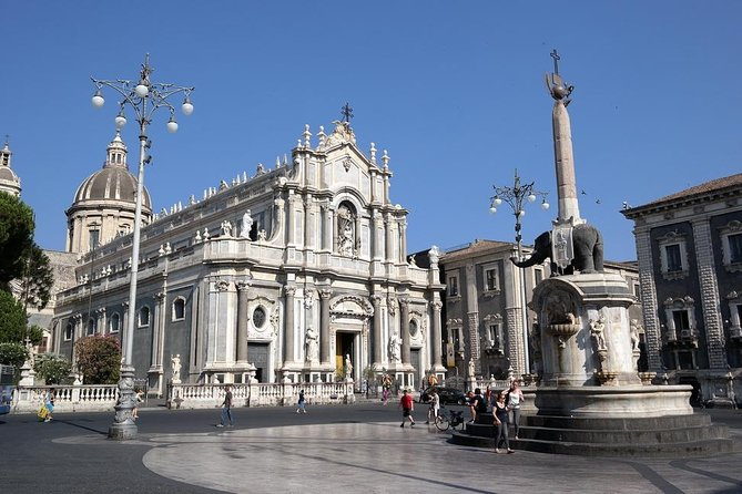 Private tour by comfortable car for two or more travellers to Catania, the city made of lava from the neighboring Etna volcano. With your private tour leader you will visit the most important sights, learn the amazing history, walk through the magnificent streets and parks of Catania, 'the black city,' as well as taste traditional street food of Catania, such as arancini (rice balls with ragout) and traditional pitone (pies with prosciutto, mozzarella, tomatoes) with a glass of Etna wine. Optionally, you may taste superb Sicilian wines accompanied by fresh, traditional food at one of the best wine restaurants of Catania.
