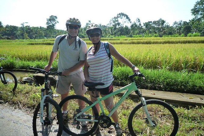 """The cool morning is ideal to begin your """"downhill cycling tour"""". Drive to the north-west of Bali to the village of Luwus and on route you will enjoy views of countryside, then drive about 10 minutes from the main road to where your bicycles and helmets will be waiting.<br><br>A relaxed, good, fun cycling descents through local craftsman at work, a landscape with lush and fertile vegetation. This amazing tropical island is still rich with distinctive customs and culture.<br><br>The smiling face of the Balinese await your arrival, an invitation to their traditional compound and temple.<br><br>Fabulous refreshment stop! Continue cycling amongst field of local fruits and vegetables. Higher altitudes offer scenic views of the beautiful mountains and terraced rice fields. Support vehicles follow behind. Finish at Gulingan Village to enjoy your delicious Balinese snack, sit back and experience this wonderful tropical Bali."""