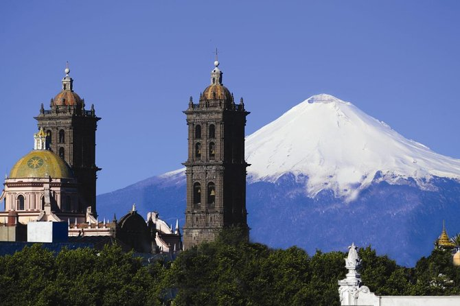 "This tour offers a visit to two of the most emblematic cities of this region: Puebla and Cholula and the smallest volcano in the world Cuexcomate.<br><br>According to the legend, a bishop was told by angels the specific location of the future city of Puebla. <br><br>By the ""City of Angels"" there is a picturesque road, guarded by two active volcanoes Popocatepetl and Iztaccihuatl, snow-capped peaks that rush into the sky. <br><br>The city itself will amaze you with its splendid colonial architecture, historical monuments, like: Rosario Chapel, Convent of Santo Domingo, the city's cathedral (protected by UNESCO).<br><br>Puebla City, also is the second most important Spanish colonial city."