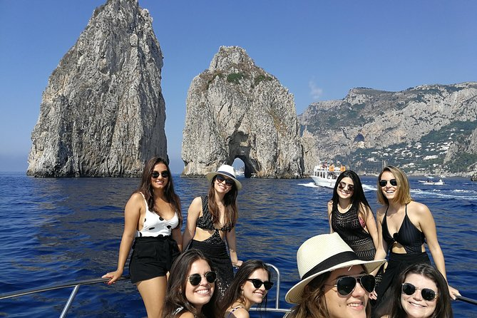 "Cruising Capri Island on a comfortable yacht will be the best experience of your holiday.... swimming and snorkeling the impressive crystal clear emerald water of the blue island....While sailing in totally relax having an happy hour with snacks, ""Caprese salad"" whith local fresh mozzarella and cherry tomatoes holding a glass of prosecco whith good background music and beauty of Capri in your eyes! <br><br>What will make unique this experience is take you into unknow grottos and Roman ruins outside the tourist circuit that only few sailors know making you feel like local.<br><br>On board you will have a complete commentary in English. <br><br>Including in the price:<br>- VAT.<br>- All Risks insurance. <br>- Diesel consumption.<br>- Beverages<br>- Towels and snorkel kits"
