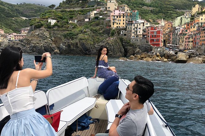 Enjoy a romantic sunset boat tour with this private 2-hour cruise along the Cinque Terre. Watch the sky light up in different colors as you admire the Cinque Terre villages from the water. Sip wine and eat olives and focaccia (additional expense) during the tour.<br><br>Head to Riomaggiore's marina and board your boat for an evening cruise. <br>The route takes you into a marine protected area, alongside the shores of the UNESCO World Heritage–listed Cinque Terre. The region is famous for its rugged coastal landscape and its five fishing villages that are stacked into the hillside above the sea. <br>As day turns to dusk, gaze out at the winding trails that connect the villages, and glimpse stretches of a 19th-century railway line that tunnels through the cliffs. <br><br>Through your 2-hour cruise, snacks and wine are available.<br><br>Nibble on olives and flavorsome focaccia, and sip on UNLIMITED glasses of wine as the sun sets. Your cruise ends back at the marina.