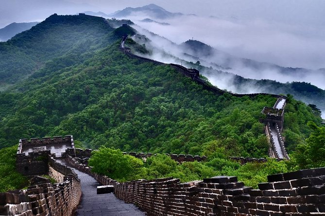Start the day off by visiting the well-known Mutianyu Great Wall, located only 70 km outside of Beijing. With our VIP access, entry will be a breeze as we bypass the crowds and lines, ensuring you maximize your time and don't miss anything this historical attraction has to offer.<br><br>You will be free to explore the wall easily on your own, have more time taking pictures and making memories on the Great Wall, round-trip cable car rides will be available for you to ascend and descend the Wall. If you are feeling adventurous, trade in your cable car ride down, jump on the toboggan and take a thrill ride to the foot of the mountain.