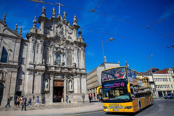 Travel two sightseeing routes in and around Porto by open-top double-decker bus to see all the sights of the city and neighboring Matosinhos and Gaia. Hop on and off as often as you like to see the attractions you want to see when you want to see them – is the perfect introduction to the area! <br><br>On the Porto route, feel the wind in your face as you ride down grand avenues like Avenida dos Aliados, and then hop off in the historic Carmo neighborhood with its sculptured Clérigos tower. Or stay on the bus, and get off at following stops, such as Castelo da Foz. <br><br>Switch to the second route to explore what's outside of Porto – spend time in the cafe enclave of Gaia's port, and check out the beaches and seafood restaurants in Matosinhos.<br><br>Upgrade to include a river cruise and wine tasting!