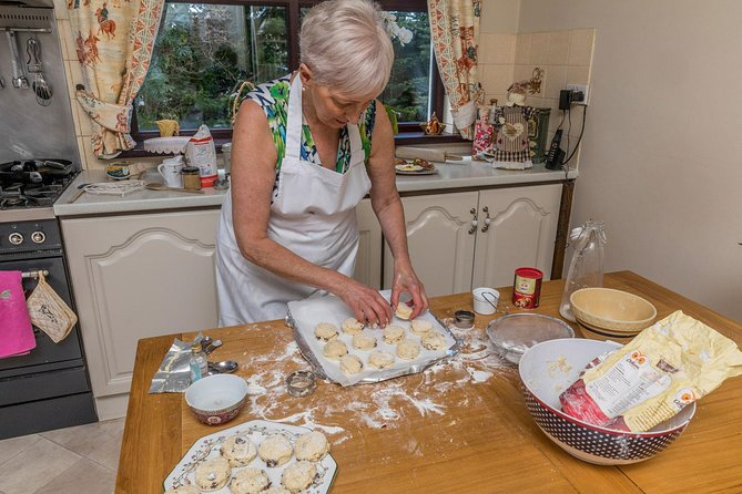 Marjorie is a charming and outgoing Irish woman who loves meeting people and sharing her passion for food. Join your host Marjorie at her small but charming kitchen to learn to cook a traditional Irish meal from recipes out of her own cookbooks, many of which have passed down through generations in her family. Marjorie loves to bake so most of your meal will be straight out of the oven. Enjoy a hands-on Irish cooking class that will last about an hour and a half. Roll up your sleeves and learn to make 2-3 traditional dishes from scratch with fresh ingredients, some that may have even been procured from your Marjorie's garden. Your baking class will include learning to bake homemade scones, Irish soda bread or a traditional fish pie. Learn from an expert about the tips and techniques involved in home style Irish cooking before you sit down at the table to share the meal you helped prepare with Marjorie.