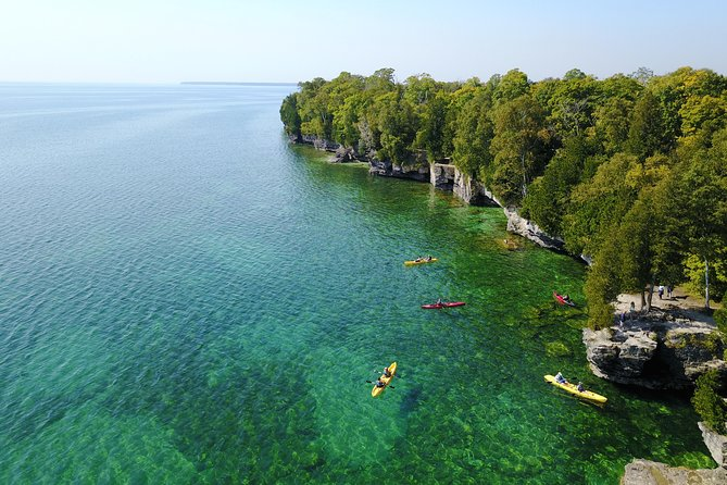 This kayak tour sets off to see a few of the many precious gems of Door County. <br><br>You will experience thousand year old caves, ancient fossils, and Whitefish Dunes State Park.<br><br>After an introductory lesson and a calm launch from a location north of Cave Point, you'll follow the coast until seeing the coves of Cave Point County Park where you'll creep along listening to the wonderful sound of the water and enjoying the view of the caves. Then explore the caves with the kayaks, and finally head towards Whitefish Bay Dunes State Park. <br><br>At this point, you will turn around and return to the launch location or head to the take-out point at the Whitefish Bay Town boat launch (dependent upon the wind). The caves are not viewable from the land. <br><br>Our kayak launch location and close meeting location make our company the #1 reasons to use us for your Cave Point Kayak Tour. <br><br>Book direct on our website please. DoorCountyKayakTours.com