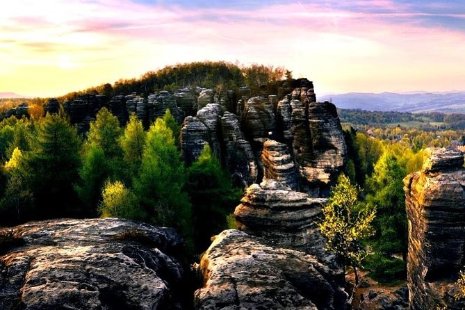 Experience the best of the Bohemian and Saxon Switzerland National Parks without having to worry about transportation on a full-day small-group tour. Travel to the parks by comfortable air-conditioned vehicle and enjoy all seasons avaliable guided hike to landmarks such as the Bastei Bridge, Sněžník Lookout Tower and Tisa Rock city (The Narnia Labyrinth). Lunch, entry fees, snacks, bottled water and hotel pickup and drop-off are included.<br>