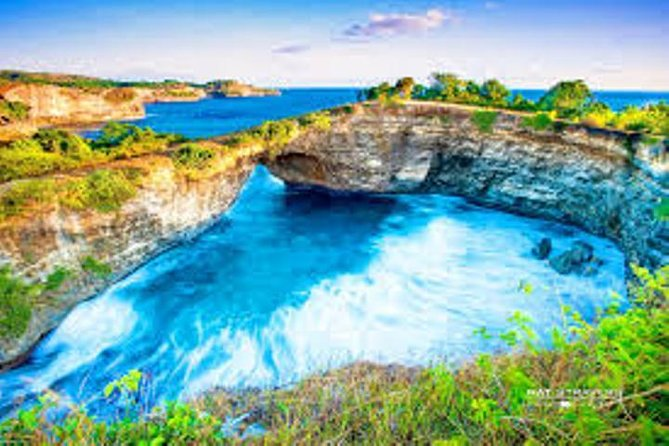 Enjoy a full day small group tour to Nusa Penida Island Village. You will enjoy a scenic return boat trip from Sanur to Nusa Penida Village. You will then be able to explore Uwug Beach also known as Broken Beach, Billabong Beach, Kelingking Secret Point Beach, Paluang Temple ( car Temple ) Nusa Penida   with a driver as cum guide . You will also enjoy Coconut water and lunch is provided. Finish off your day by Relax on shore at Crystal  Bay Beach