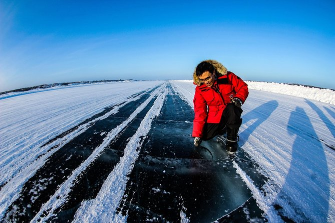 Explore Yellowknife - Dettah Ice Road on Great Slave Lake one of the world largest and deepest lake on hour and half trip guided tour.