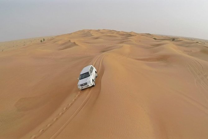 Depart in the afternoon, for a thrilling desert drive over the golden sand dunes, deep into the heart of the desert. A fabulous view of the sun setting over the desert dunes are some of the memories you will cherish from the desert drive. Arrive at the desert camp, where a traditional Arabian welcome awaits each of you. Enjoy the true Arabian ambiance, at this typical Bedouin campsite, with traditional Arabian carpets, low tables and cushions for comfortable seating. At the desert camp, experience the camel ride, sand boarding, henna painting or simply enjoy the aromatic Sheesha. Enjoy the sumptuous buffet dinner with a wide variety of barbecue meats, salads, main-course and deserts. The climax of the evening is the stunning performance by the exotic belly dancer, tanoura dancer under the star-lit sky (except during religious holidays or government orders).
