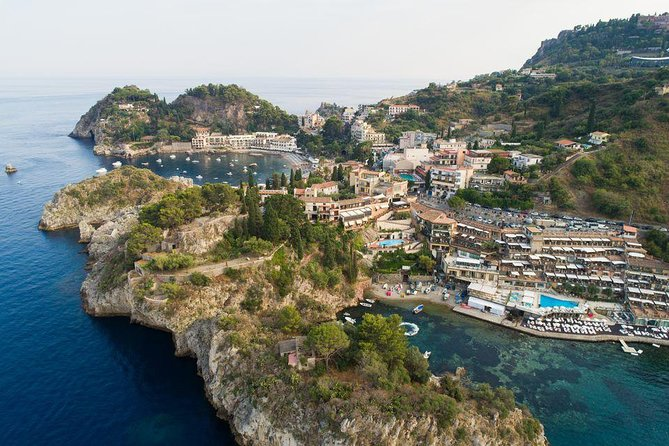 An amazing experience through Etna area to discover the Volcano and its lava fields and then a short walking tour of famous Taormina and of Castelmola: the balcony over Taormina and its amazing bay !<br><br>ENJOY YOU THE ASSISTANCE IN ENGLISH LANGUAGE, DURING THE DAY TRIP AND OUTSIDE THE MUSEUMS OR ARCHEOLOGICAL AREAS , FOR ONLY € 75 (IT IS NOT AN AUTHORIZED TOUR GUIDE SERVICE- IT IS ONLY AN ASSISTANCE.