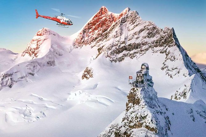 Exclusiv Jungfraujoch trip ❤️ by, helicopter and train, incl. hotel pick up. This fantastic day trip is a must during your stay in switzerland. Very comfortable, we pick you up at your hotel. You make a helicopter flight with top views and experience the return journey with a train ride.<br><br>Private tour and best price per person if you book for 5 people.<br><br>The feasibility of the helicopter flight is reserved. Despite the good weather, a flight can be canceled or postponed due to excessive wind or snow drifts on the Jungfraujoch. In this case, the tour can still be made by train. We do our best to bring you safely and comfortably to the Jungfraujoch. <br><br>Expiration example 5-8 hours:<br><br>09:35 departure Interlaken (example)<br><br>11:35 arrival Jungfraujoch <br><br>13:45 return by Helicopter to heliport<br><br>14:00 limo back to the hotel<br><br>or<br><br>13:15 limo service hotel to heliport<br><br>13:30 helicopter flight Jungfraujoch<br><br>16:13 departure train (example)<br><br>18:23 arrival in Interlaken