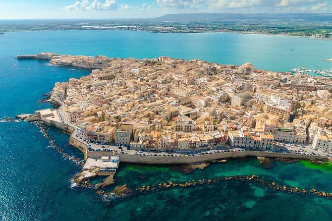 • Visit Siracusa, one of the most important cities of Sicily with its splendid archaeological park <br> • Take a walk on the island of Ortigia, the core of ancient Greek Sicily <br> • Enjoy a walking tour of Noto with its magnificent late baroque architecture