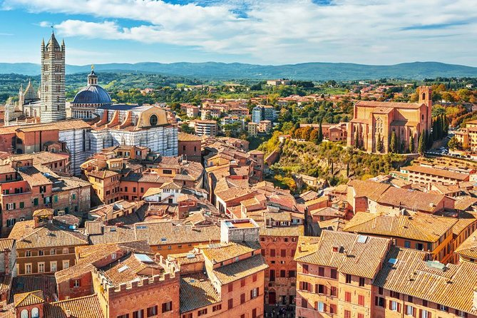 Enjoy a full-day tour into the heart of the beautiful Tuscan countryside. <br><br>Visit the town of San Gimignano, the wine territory of Chianti, the medieval town of Siena and the Monteriggioni fortress.