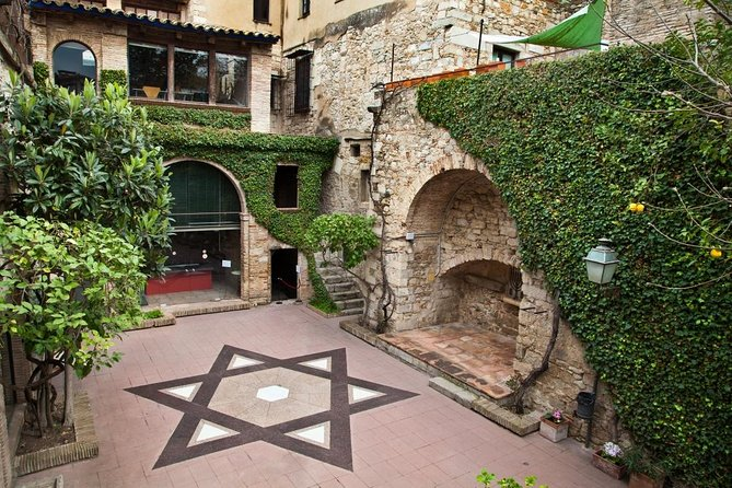 "The Jewish neighbourhood of Girona is one of the best preserved in Europe.<br>This district located in the heart of the city is full of ancient remains from its Roman and Medieval past. Known popularly as the ""Call"", this area was home to 1000 inhabitants during the Middle Ages, making it one of the most important Jewish communities in Spain's history. As you explore the pretty narrow streets of the Jewish Quarter, the hometown of Nahmanides, the Medieval Kabbalistic philosopher, you'll visit the spots where the city's 3 synagogues were located, you will find out all about the customs and traditions of the Jewish people. You'll also visit the Museum of Jewish History to learn about their way of life. Your guide will then lead you around the labyrinthine streets while explaining the history of the Expulsion of the Jews in 1492, an act that ended 600 years of coexistence. After this visit you'll have newfound knowledge of about the influence that the Jewish community left in Girona."