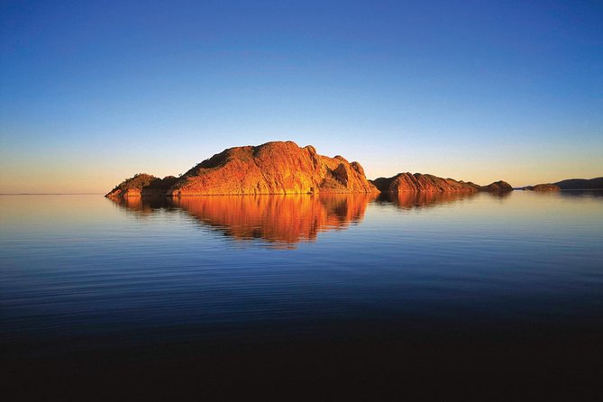 This tour is the best (and only) way to experience the full length of Lake Argyle. It includes all the highlights from our Sunset Magic trip & much more. Travel over 120km from the Rugged North to the Southern Reaches.<br><br>Take a gander through the binoculars (provided by us, welcome to bring your own) for an up-close look at the many different species of birds and other wildlife including wallabies and crocodiles.<br><br>Stop on a remote island to fossick for the intriguing Zebra Rock, with its perfect stripes & spots that can appear to be painted on, unique to Lake Argyle.<br><br>We'll cruise past the submerged site of 'Argyle Downs', the Durack Family's Homestead, while listening to stories about the pioneering families & how they began the pastoral industry in the East Kimberley.<br><br>We'll enjoy the changing colours reflecting across the lake near Monsmont Island, the best spot on the Lake for sunset! Enjoy afternoon tea before stopping for a refreshing swim with complimentary beer/wine/champagne.