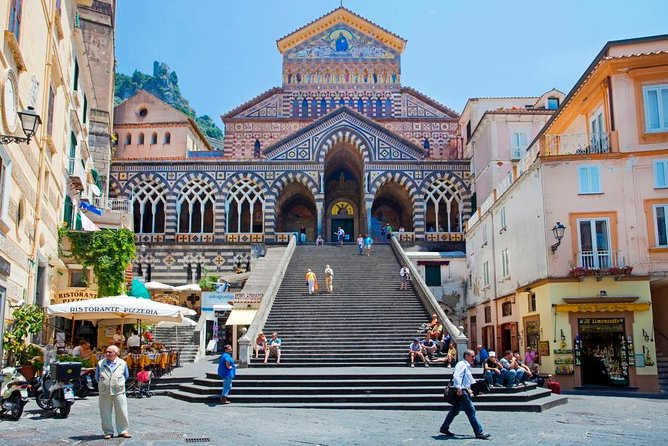 Fall in love with one of the most scenic coastal landscapes in Europe on this full-day tour of the Amalfi Coast from Sorrento. <br><br>The UNESCO-listed Amalfi Coast has long been a sanctuary to the rich and famous, with the likes of Greta Garbo, Humphrey Bogart and Jackie Kennedy having sought serenity here — and now it's your turn. <br><br>Enjoy a relaxing coach ride from Sorrento along the Amalfi coastal roads:<br>- The first stop will be high above Positano (only photo-stop/no visit), one of the jewels of this<br><br>coastline;<br>- then proceed to Amalfi to get your free time to explore its cobbled backstreets;<br>- continue to the medieval town of Ravello which nestles in the mountainside eleven hundred feet above the sea and where you can enjoy the best views of the Amalfi coastline overlooking Minori, Maiori and beyond.<br>- Finally a visit and tasting at a Limoncello Factory on the return way!<br><br> and visit the towns and villages of Amalfi and Ravello. <br><br>Meals are at your own expense.