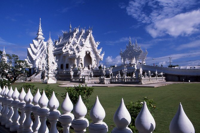 """This is a half day tour aimed at taking you to the main sites of Chiang Rai. Visit the main market area and Wat Phra Kaew Chiang Rai, where the famous Emerald Buddha (in Bangkok) was found in A.D. 1434.<br><br>Visit also Wat Doi Thong, with its Navel Pillars, overlooking the Mae Kok River, and King Meng Rai's Monument with its annual festival in February. Then visit Wat Rong Khun, also called """"The White Temple""""; inside it contains murals and paintings of the Buddha image and painted enamel ceramic floor. The outside was created with lime sculpture Thai designs decorated with small pieces of mirror that make the building sparkle and shine under the sunlight."""