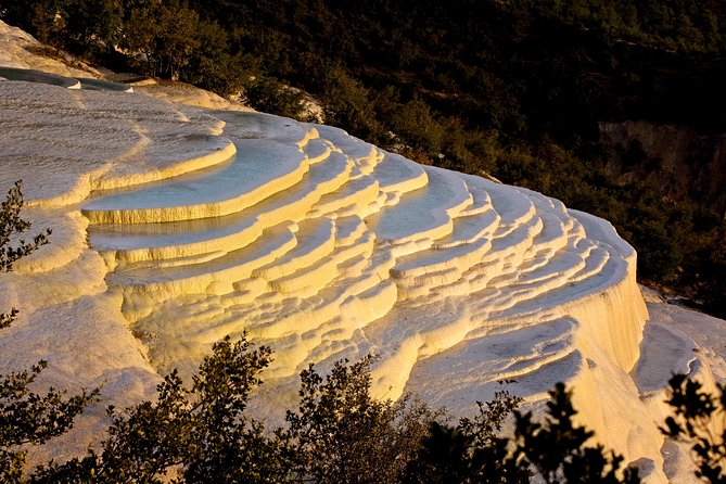 White Water Terrace (Baishuitai) is located in Sanba Township 100 kilometers (62 miles) from the Shangri-La county seat. Measuring 140 meters (about 459 feet) in length and 160 meters (about 525 feet) in width, it is one of the biggest such terraces in China. The terrace is covered by a layer of white deposits of calcium carbonate crystallized in the spring water. In addition to the spectacular terrace itself, visitors can also learn about the ethnic Naxi minority and folklore in the nearby Baidi village.<br><br>Tiger Leaping Gorge is the longest, deepest, and narrowest gorge in the world. Around 18 km(11.23 miles) in length, it is located at the upper reach of the Yangtze (Jinsha) river.