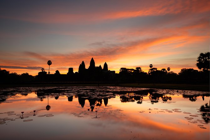 Watch the sun rise over the triple towers of Angkor Wat and experience an unforgettable day bicycling among the ruins of the Angkor Kingdom. With an entertaining and informative local guide, you'll ride the back roads to iconic temples in the Angkor Archaeological Park. Walk around one of the world's great monuments at its quietest and most inspiring, and enjoy a delicious Western breakfast and Khmer lunch. Includes round-trip transport by minivan from Siem Reap. Numbers are limited to six participants to ensure a personalized experience with a small group.