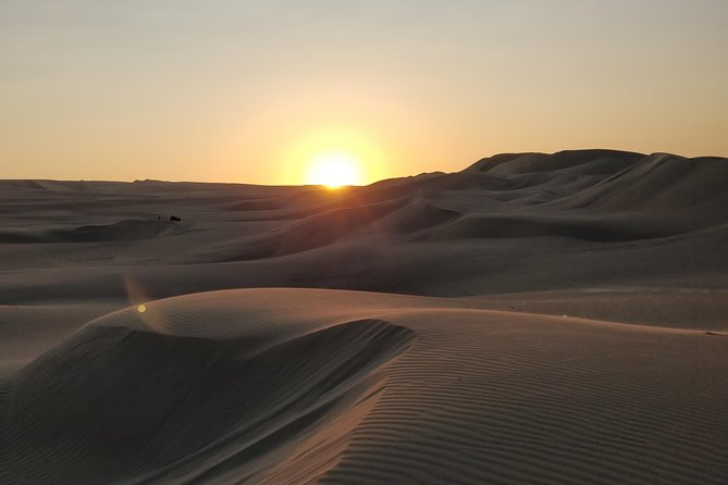 You will be picked up from Doha by our well experienced and professional l desert drivers and head towards the South of Qatar for a stop at Sea Line while the driver deflate the tires to make the vehicle ready for off-road. our driver will take you over the dunes for a thrill dune bashing and watch the beautiful sunrise over the dunes. This will be one of the experiences you will never forget. You will also see the magnificent Inland sea, where you will get to see the borders of Saudi Arabian the way back you will stop for a quick camel ride at local camel camp where you can enjoy a local tea.