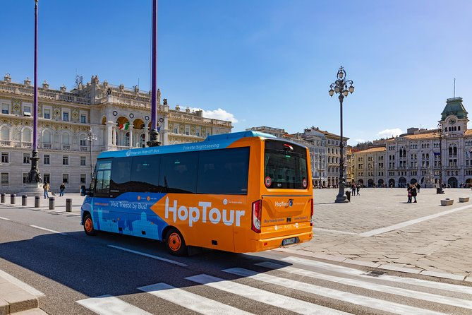 Discover the sights of Trieste with hop in hop of tour 24 hours ticket, in comfort aboard an air-conditioned bus equipped with audio guides synchronized with the route to provide information about all the attractions you will see. Climb aboard at the Molo Audace pier, and then sit back and relax as you travel around the historic city center. <br><br>See all the most beautiful attractions of Trieste by bus <br><br>Learn the history of the city from the on-board audio guides <br><br>Benefit from free Wi-Fi and USB chargers