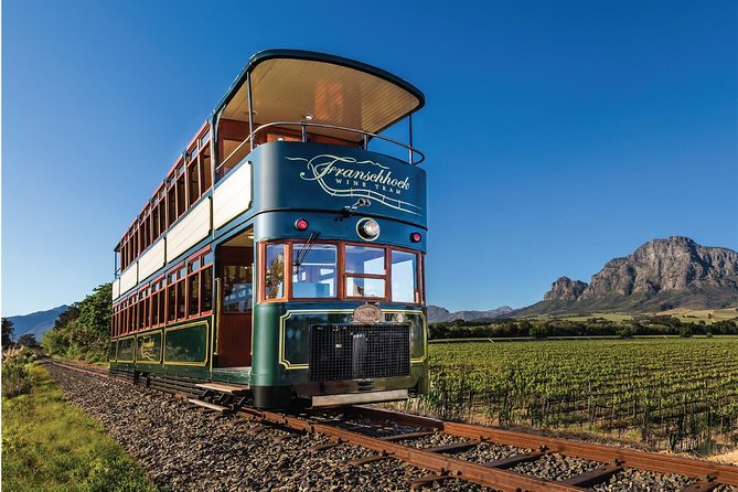 The Franschhoek Wine Tram hop-on hop-off tour is one of the best ways to discover the true essence of this picturesque valley, its rolling vineyards, breath-taking scenery, warm hospitality, world-class cuisine, fine wines and a 300-year history. This tour includes a return transfer from Cape Town in a luxury air-conditioned motor coach and a full day riding the tram and tram buses around the wine estates.