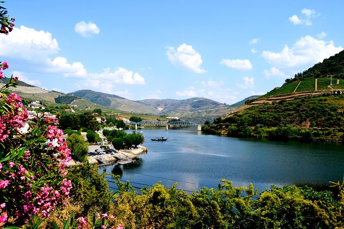 Visit Portugal's prestigious Douro Valley on this full-day wine tour from Porto! Famous for its production of port wine, this UNESCO World Heritage-listed region is indisputably scenic, with swathes of vineyards clinging to the hills around the Douro River. Admire the scenery around the village of Pinhão, enjoy a traditional lunch of regional specialties and visit a winery estate for a tasting session of award-winning local wines. To enjoy more of the countryside on the way to the Douro Valley, upgrade to include a sightseeing rabelo boat tour along the Douro River, departing from Pinhão.<br><br>Numbers are limited to eight people on this small-group tour, ensuring a more personalized experience.