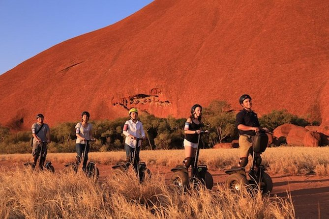 Join us for an incredible Uluru Sunset Experience that you won't forget. We'll pick you up from your hotel and journey by bus to Uluru. Upon arrival at Uluru you guide will lead you into the famous Mutitjulu waterhole, where you can marvel at ancient Aboriginal Rock Art. After this we'll teach you how to Segway and set off and cruise a quarter of Uluru's massive base. After a cruise your guide will lead you on foot to visit the ancient caves of the Mala Walk. As the afternoon comes to a close we'll set up a sunset picnic for you, with nibbles and sparkling wine.<br><br>Includes:<br> • Segway a the most scenic quarter of Uluru's impressive base<br> • Guided walk into Mutitjulu waterhole<br> • Guided Mala Walk<br> • Sunset picnic with nibbles & softdrinks<br> • Transfers to and from Ayers Rock Resort<br><br>Not included: <br> • National Park Entry Ticket