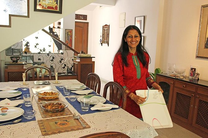 Meet Binu, a friendly, well-traveled, cosmopolitan host, in her beautiful home surrounded by lush gardens in the heart of Bengaluru for your private cooking experience. Discuss the menu over a welcome drink before joining Binu in her kitchen for your cooking demonstration. Watch as Binu prepares an authentic Indian meal that focuses on meat, stuffed Indian breads and quick vegetable stir-fries. Binu prides herself on making homemade breads and authentic curries and enjoys feeding people. Binu may be joined by a member of her staff to help prep and clean in her kitchen. <br><br>Join Binu at her dining table to relish an authentic North Indian Punjabi meal. You might try dishes such as stuffed parathas, aloo gobhi (potatoes and cauliflower stir-fry), bhindi masala (spiced okra), paneer bhurji (scrambled Indian cheese with vegetables), Binu's signature mutton, and methi chicken (chicken cooked in fenugreek leaves). You will end your meal with a sweet dessert like kheer (rice pudding).