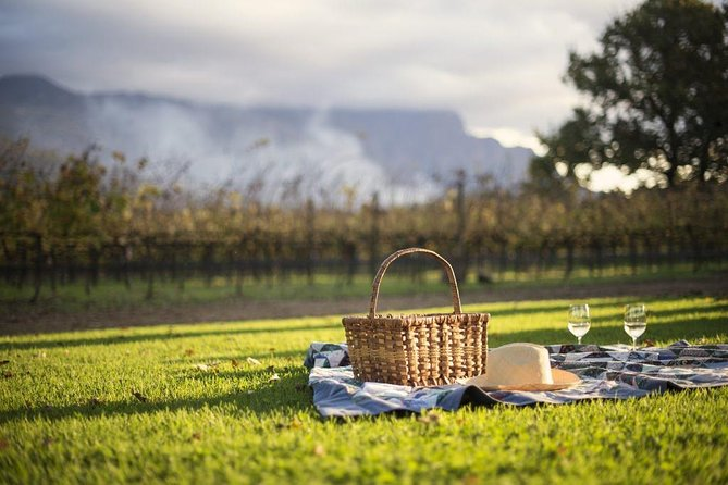 Oenophiles and nature lovers alike are in for a treat on this private exploration of the Cape Winelands. Not only do you visit three esteemed wine farms for fine wine tastings and phenomenal pairings with cheese and chocolate in the Paarl, Stellenbosch and Franschhoek regions; the extraordinary scenery along the way will transport you back to yesteryear to reminisce among white gabled buildings and impressive manor houses flanked by soaring mountain ranges. <br><br>Firstly you'll visit the cheese haven of Fairview for a master tasting of their wine with local produce. Continue to the historically rich La Motte wine estate for another tasting and insider view of their maturation cellar. Visit the self-proclaimed culinary capital of South Africa, Franschhoek for a lunch stop and end your meander along the Winelands with sweet port-style wine and chocolate pairing at the heritage-rich Muratie wine farm before heading back to Cape Town late afternoon.