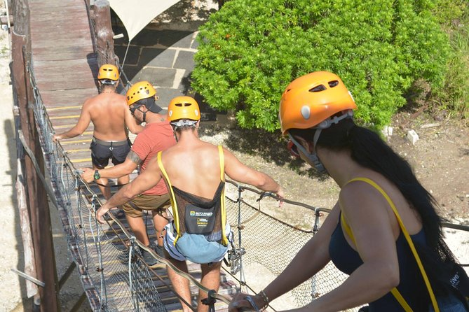 There's no shortage of adventure and spectacular sites on this full-day tour from Playa del Carmen. Wander the ancient blufftop city of Tulum, stroll along its pristine beach, and ride a Mercedes-Benz Unimog, a monster truck that whisks you to rappelling and zip-lining locations inside the Yucatán jungle. Discover the underground caves of Sac Actun and Nohoch Nah Chich, and snorkel around stalagmites. Swim in cenotes, partake in a Maya purification ritual.<br><br>Currently, our archaeological sites remain temporarily closed for an unspecified time, meanwhile adaptations are taking place for the new health and safety measures procured by our authorities. We all are looking forward to this reopening. In the event of acquiring the activity in conjunction with an archaeological site and this should continue to be closed by the time of your visit. We will be able to carry out the rest of the activity and the cost of the visit to the archaeological zone will be reimbursed.
