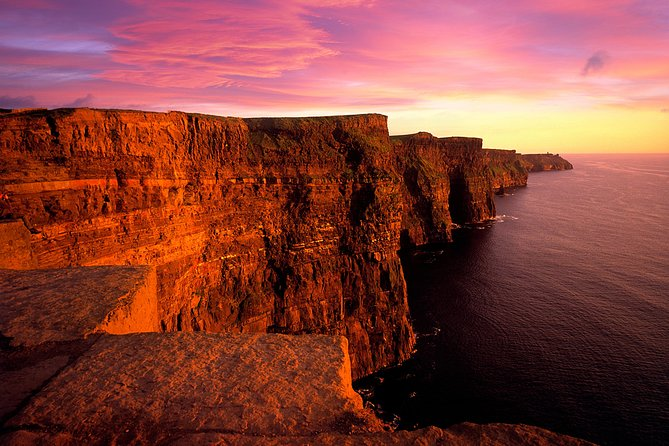 Join this spectacular journey along the breathtaking Wild Atlantic Way, through the lunar-like landscape of the Burren and on to the iconic Cliffs of Moher. See medieval ruins, 16th century tower house castles, churches, graveyards, drystone walls, quays, harbours, ponies, calves, cows, lambs, sheep and maybe even a leprechaun or two! <br><br>Driving along the coast of Clare, witness the power of the Atlantic Ocean as it battles the coastline. Board the ferry in Doolin for Inisheer, the smallest and nearest of the Gaeltacht Aran Islands. Keep an eye out for local bottlenose dolphins that occasionally follow the ferry. On Inisheer, explore ancient castles, churches, narrow lanes, stone walls and deserted white sand beaches. <br><br>The return ferry takes you on a guided scenic cruise beneath the spectacular Cliffs of Moher. Returning to Doolin, you go to the top of the Cliffs of Moher where you can take a stroll along the Cliffs. Departing the Cliffs you return to Galway.