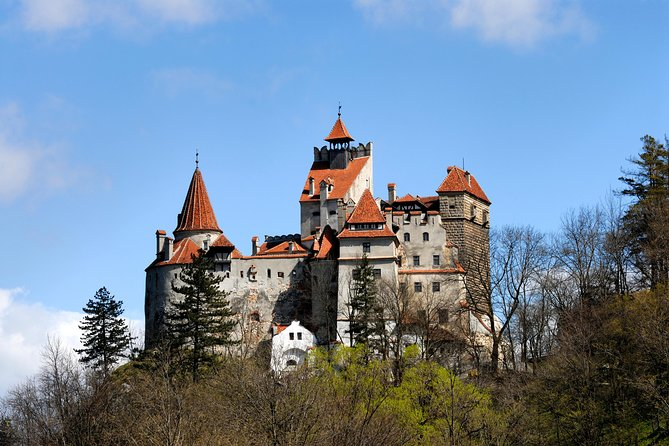 Discover Bran Castle, known as 'Dracula's Castle,' and Râșnov Fortress on this 4-hour small group tour from Braşov. Travel to Râșnov to explore its stunning 13th-century fortress, and then visit Bran Castle, the turreted hilltop palace linked to Bram Stoker's fictional Count Dracula. Walk through the spooky rooms and hear tales about Vlad the Impaler, the 15th-century noble who was imprisoned here and inspired Stoker's blood-stained vampire. Upgrade to extend your tour to the beautifully ornate Peleș Castle (to be paid when you are doing the booking by choosing the option!).