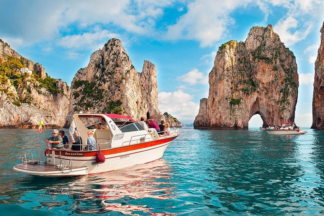 """A boat tour around Capri is the perfect way to discover the island at a relaxed pace sharing the happiness with a small group of people ( max 12) on board. We will pick you up with a free shuttle to your hotel and we will leave from the port of Massa Lubrense sailing under the coast towards Capri with a first stop at the Marciano natural waterfall to take some amazing photos,to show later to your friends once you'll be back home, and take a refreshing bath. We will continue towards Cala di Mitigliano and Punta Campanella, the extremity of the Sorrento Peninsula to arrive in Capri welcomed by the Salto di Tiberio, a precipice overlooking the sea, and Villa Jovis immediately followed by the """"Grotta del Corallo"""" and the """"Grotta Bianca"""". The tour will continue sailing towards the Faraglioni Rocks, the Natural Arch of Capri and Villa Malaparte. The first part of the tour will end with a stop for a swim in Marina Piccola with a view of the Faraglioni, before a landing on the island for a stop of about 4 hours. On board we will provide you a packed lunch with vegetarian sandwich and beverages! The return journey is approximately 40 minutes, a free shuttle to the hotel will be waiting for you at the port.<br><br>"""