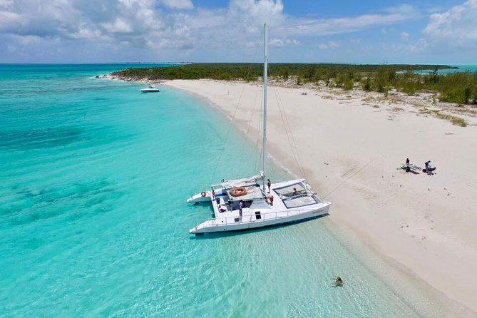 Set sail for a relaxing Caribbean journey on this half-day cruise and snorkeling excursion from Providenciales. Hop aboard a world-class catamaran, operated by a friendly and professional crew, who attend to your comfort while sailing along the coastline of Grace Bay. Watch for dolphins as you soak up the sun and enjoy rum punch with your chips and salsa snack. You'll set anchor at a secret reef for an opportunity to swim and snorkel in the warm waters of Turks and Caicos.