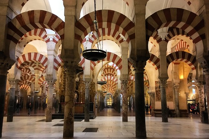 Take a day trip from Seville to discover the cultural, historical and religious gems of Cordoba. Explore the Jewish Quarter and enjoy skip-the-line entry to the UNESCO World Heritage-listed Mosque-Cathedral of Cordoba, Christian Kings Alcazar and Cordoba Synagogue. Learn about the sites' Islamic architecture and take an optional walking tour of ancient Carmona to admire breathtaking views from the hilltop.