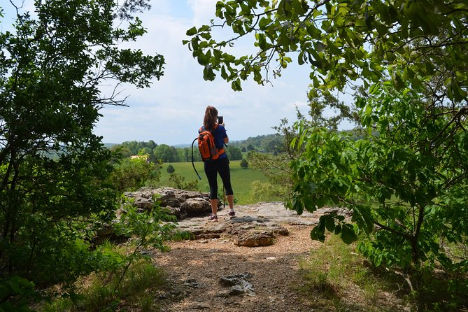 An exciting ride through breathtaking landscapes will lead us to Devil's Den State Park in Arkansas. We will cover 3 miles on easy terrain. The trail climbs up to a ridge with invigorating views of the surrounding landscape while being completely immersed in nature. A wealth of landscapes and spectacular overlooks portray the natural beauty of the Ozarks. Devil's Den truly makes you feel small, being one of the best examples of untouched landscapes in our region. We will go at a leisurely pace and take many breaks on this hike to take in the amazing views. We will end our hike with a short stroll to explore the geological features at Devil's Den State Park.<br><br>After our expedition at Devil's Den Trailhead, we will head over to Sassafrass Winery, a stellar winery found in the heart of the Ozarks. Enjoy a diverse spread of wines, along with all sorts of delicious bites to eat. End your day reminiscing on the day's beauty with fun and friends.