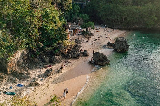 Discover Bali's white sand beaches, majestic temples, and unique culture on this 7-hour private tour. Swim in the warm waters of Nusa Dua Beach, join the surfers at Padang Padang Beach, then watch the sunset and enjoy a spectacular Kecak fire dance show at Uluwatu Temple. Hotel pickup and drop-off.