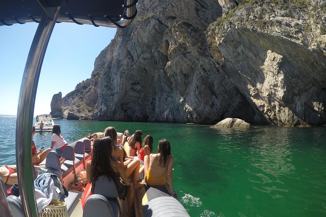 """Espichel Cape is famous for its geological wealth and country's unique limestone formations.<br><br>In this boat tour we'll depart from Sesimbra to Espichel Cape and, along our tour, we'll visit the caves and geological formations that cover this coast.<br><br>We'll visit Tamboril grotto with its zenithal lighting and crystal clear water, Frade grotto entrance – one of the biggest cave formations and galleries or the """"Mesas"""", geological formations made by marine erosion.<br><br>We'll end our boat tour to the Sesimbra´s caves with a visit to the monumental Arco da Pombeira grotto in Espichel Cape walls and to the """"Bifa"""", a singular geological formation at the cape's feet, where we can see the sea being expelled as if it was a geyser.<br><br>On return we'll stop for some snorkeling or SUP in Baleeira bay crystal clear waters!"""